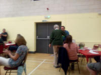 Jason Busby collects the prize for first-place team from Sal Jenkinson at the Guild Social in Holton Village Hall.