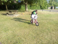 Alfie having his first practice at cycling without stabilisers.