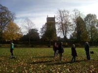 Socialising at distance in Christchurch Park beneath the tower of St Margaret's following ringing at St Mary-le-Tower.