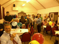 Guests gathered at Sproughton Village Hall for Dad's 70th birthday party.