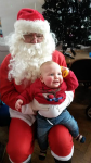 Alfie meeting Father Christmas at the Children Centre's Christmas party.