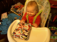 Alfie opens his first ever Christmas present.