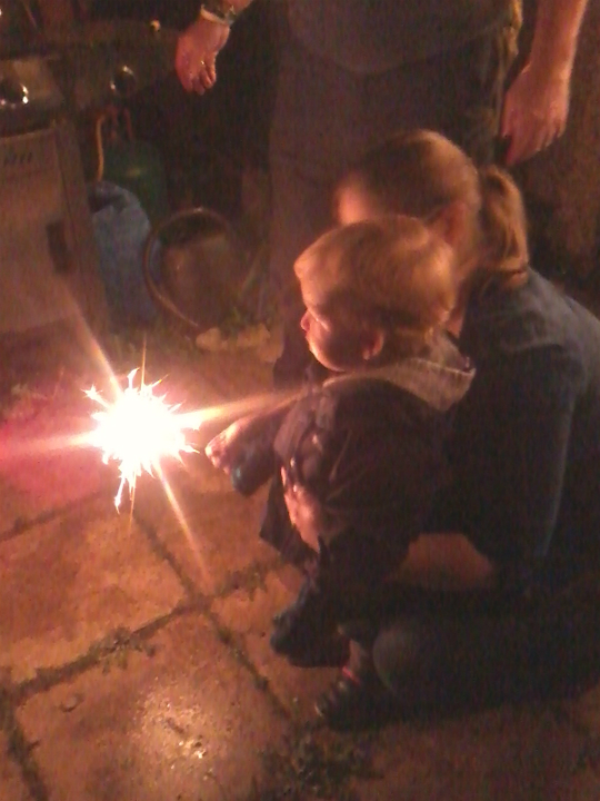 Alfie enjoying sparklers for the first time at his Granny's house, under close supervision from Mummy!