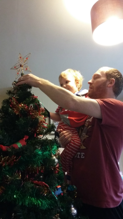 Alfie puts the star on our Christmas Tree.