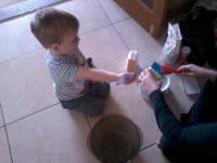 Alfie helping his Mummy make cake for this afternoon's tea.