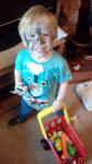 Alfie with his face painted.