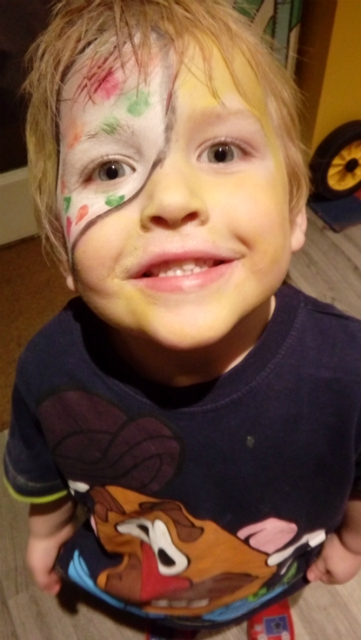 Alfie's face painted as Pudsey Bear for Children in Need.