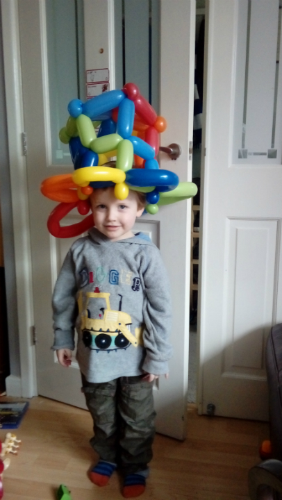 Alfie in his giant balloon hat.