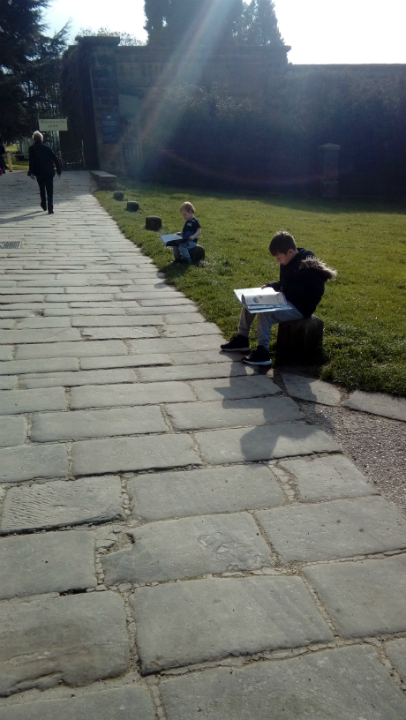 Alfie & Mason reading their new books outside Chatsworth House.