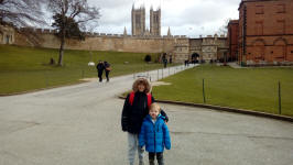 Mason and Alfie in the grounds of Lincoln Castle with the Cathedral behind.