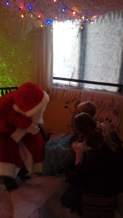 Alfie and Ruthie meet Father Christmas.