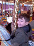 Mason on the merry-go-round at Bressingham.