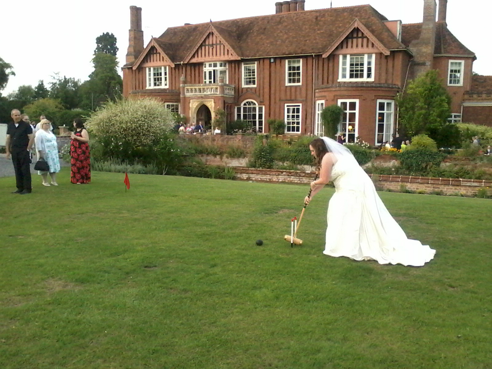 Mrs Munnings playing croquet on Boxted Hall's lawn.