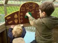 Alfie & Mason 'flying' a plane at Duxford's playground.