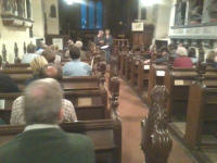 Awaiting the results of the Rose Trophy Competition in Helmingham church.