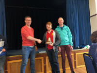 Neal Dodge collects the Lester Brett Trophy on behalf of the Great Barton band from Andrew Kelso & Brian Meads at Polstead Village Hall.