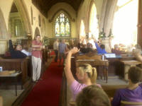 Voting for the next destination of next year's tour in the Tour Meeting in Hothfield church.