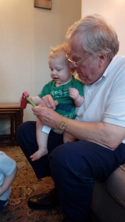 Joshua with his Grandad Alan on his first birthday.