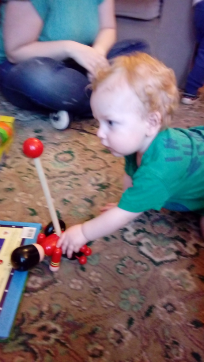 Joshua playing with one of his new toys at my Mum & Dad's on his first birthday.