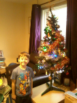 Mason next to our Christmas tree.
