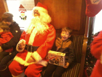 Mason meets Father Christmas.