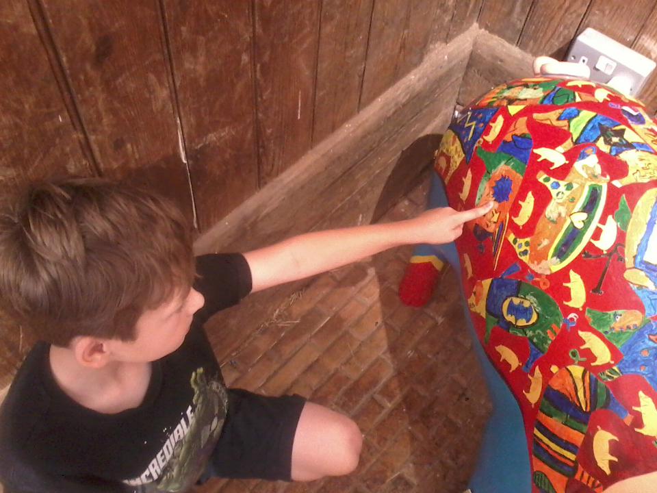 Mason pointing out the bit he painted on Pigasus!