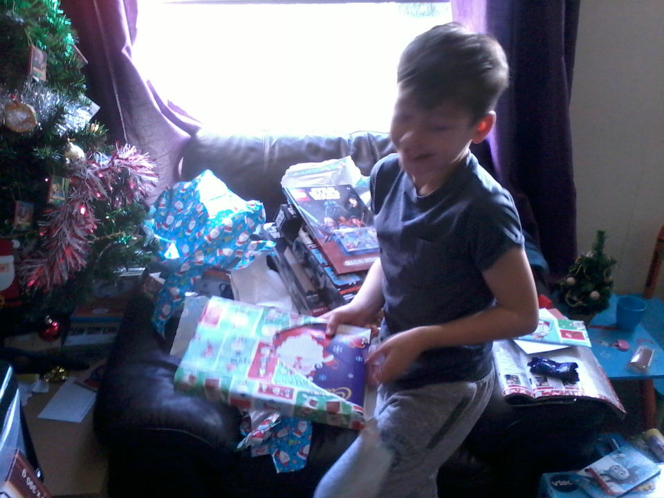 Mason tucks into his waiting presents.