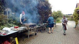 Ralph Earey, Jonathan Williamson and Brian Whiting battling the BBQ!