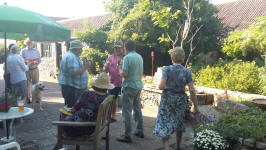 Stephen Pettman, Jonathan Williamson & Brian Whiting ringing handbells at the Offton BBQ.