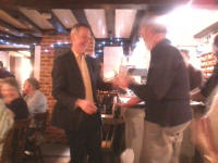 Chris Garner receives Mary's 'Monthly' Plate from Mike Whitby at the Pettistree Ringers' Dinner.