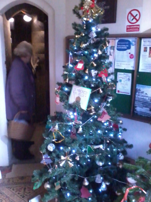 The ringers tree by the door to the stairs up to the ringing chamber at the St Mary-le-Tower Christmas Tree Festival.
