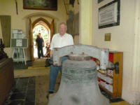 Dad with one of the bells of St Margaret's Ipswich on the church floor.