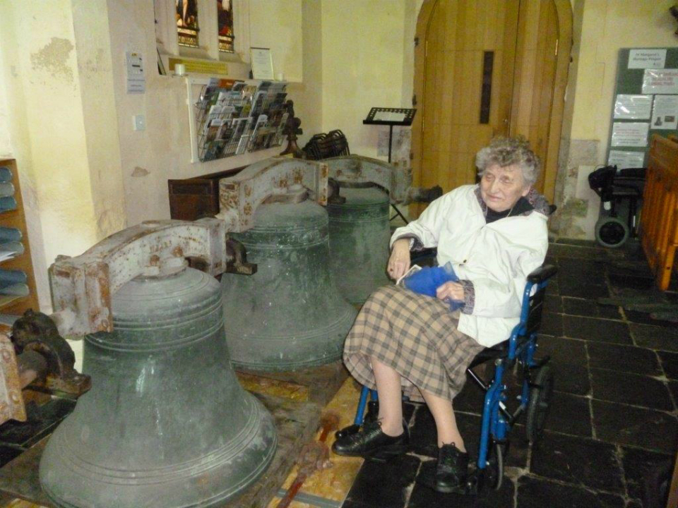 Aunty Marian with the bells of St Margaret's Ipswich on the church floor.