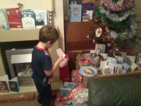 Mason reading Father Christmas' thank you note.
