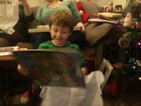Mason opens his Thomas the Tank Engine 2014 calendar.