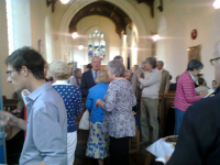 The crowds mingle after the service of thanksgiving at Clopton.