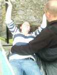 Ruthie undertaking the rather awkward operation of kissing the Blarney Stone.