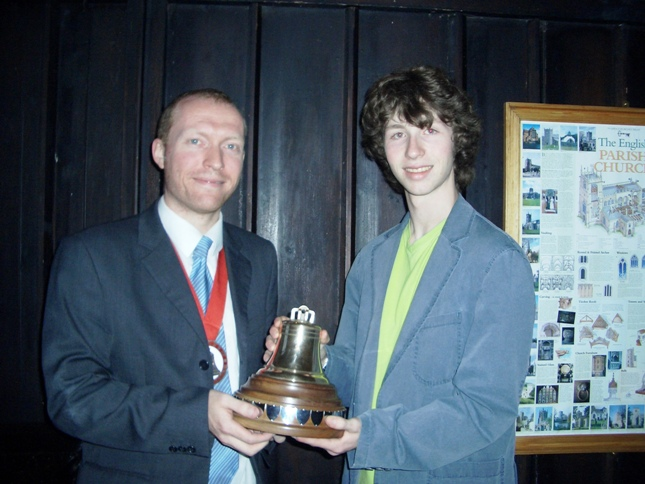 Picture of The Lester Brett Trophy being presented to Debenham by the Guild Ringing Master, Richard J Munnings