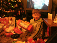 Mason gets stuck into the presents at his Nana and Granddad's.