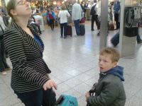 Ruthie and Mason inspecting the departure boards at Stansted Airport.