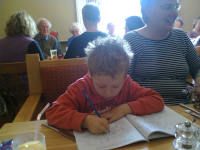 Mason concentrating on his drawing at The Five Bells at Burwell.