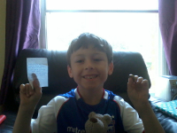 Mason showing off his gap and the note and pound coin he got from the tooth fairy!