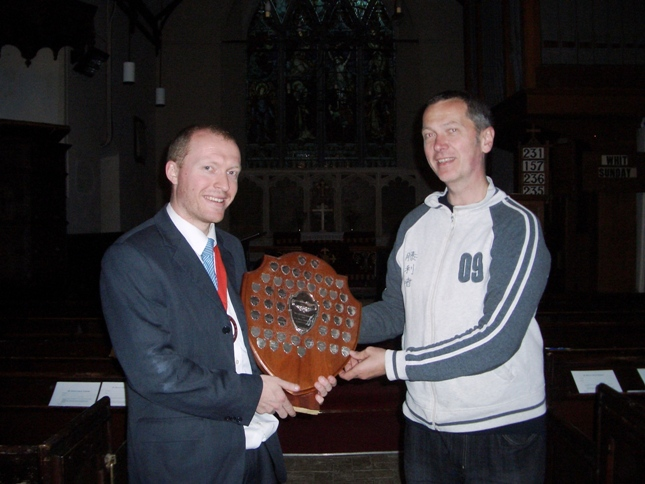 Picture of The Mitson Shield being presented to Mike Whitby of Pettistree by the Guild Ringing Master, Richard J Munnings