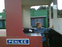 Mason enjoying being a train driver at the Leighton Buzzard Narrow Gauge Railway.