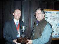 Picture of The Rose Trophy being presented to Owen Claxton of St Mary-le-Tower by the Guild Ringing Master, Richard J Munnings