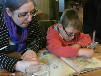 Ruthie and Mason having a drawing competition in The Ship, Blaxhall.