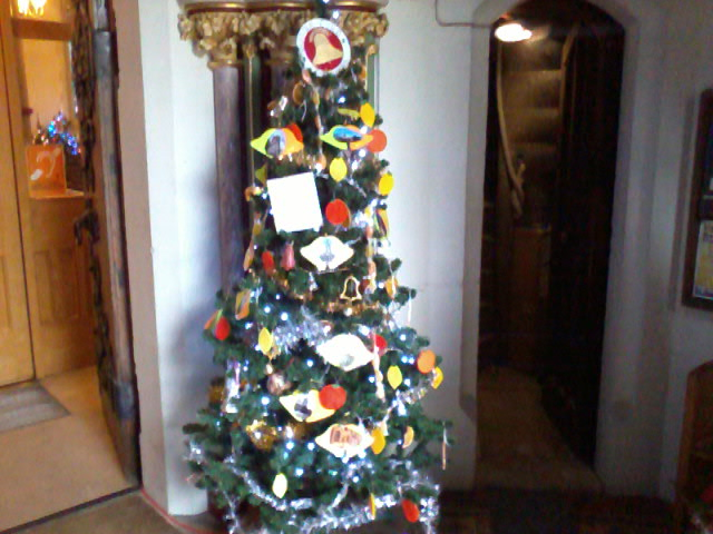 Ringers Christmas tree at bottom of stairs to ringing chamber at St Mary-le-Tower during Christmas Tree Festival.